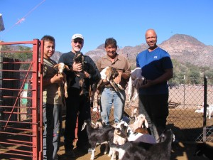 Jay, Rod, Jose Luis and son with  new baby goats at Rancho San  Isidro.
