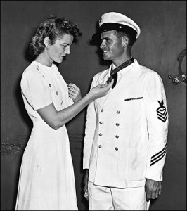 John's wife Alice admires his  newly awarded Medal of Honor.