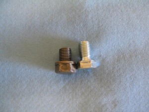 On the left is a stock KLR650 plug,  and on the right, an inexpensive,  low-profile plug from N.A.P.A..